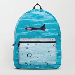 Orca Whale gliding through the water on a rainy day Backpack