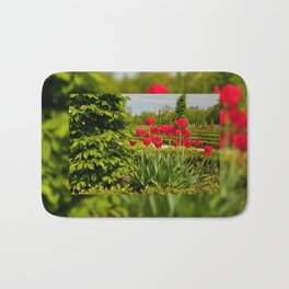 elm and red tulips arranged Bath Mat