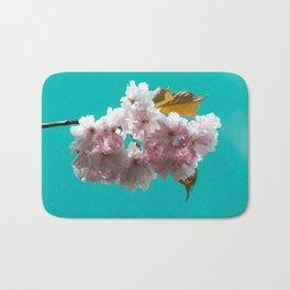 Cheery blossom green background Bath Mat