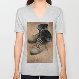Pair of old leather shoes, worn-out and dusty, on wooden background Unisex V-Neck
