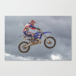 Action motocross biker in blue and red Canvas Print