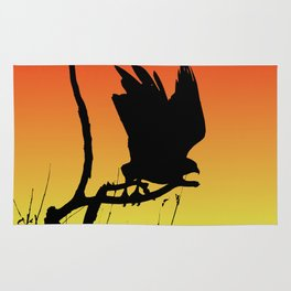 Red-tailed Hawk Taking Flight Silhouette at Sunset Rug