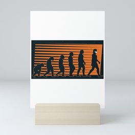 Evolution from ape to man with mask Mini Art Print