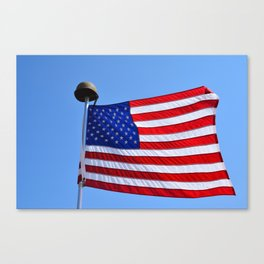 United States flag waving with a military helmet on the mast Canvas Print