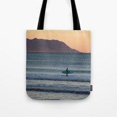 Surfer at sunset Tote Bag