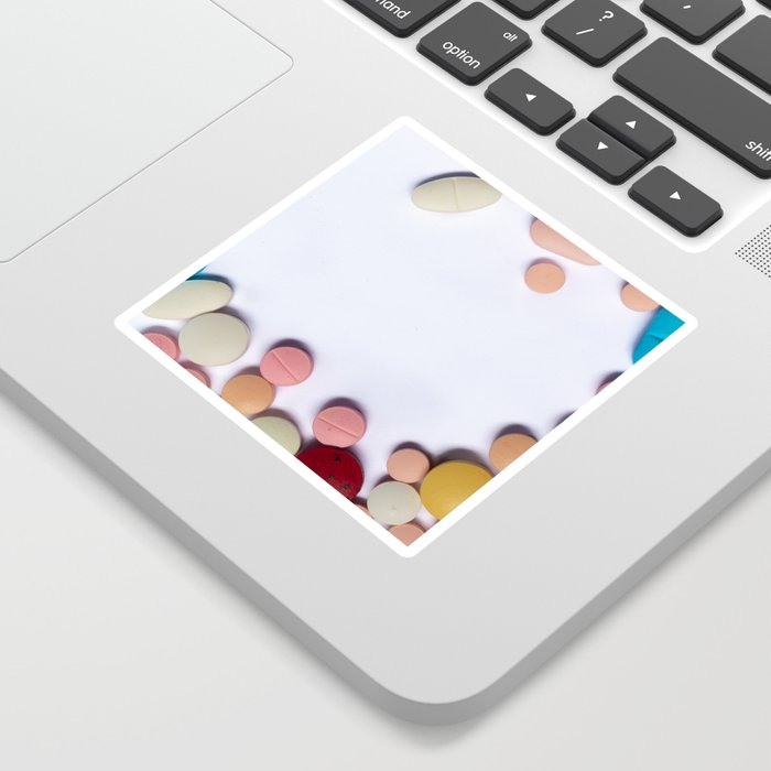 Numerous colorful pills on white background. Sticker