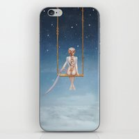 toddler iPhone & iPod Skins featuring The lovely girl shakes on a swing by natalia.maroz