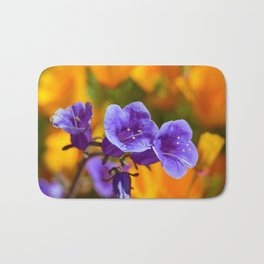 Purple Wildflowers with Gold Poppies by Reay of Light Photography Bath Mat