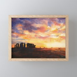 Stonhenge ruins silhouetted at sunset in the English countryside.  Stonehenge ruins artwork United K Framed Mini Art Print