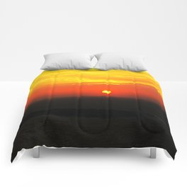 sunset in Oia Comforters
