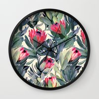 floral pattern Wall Clocks featuring Painted Protea Pattern by micklyn