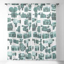 Cameras & Green Sheer Curtain