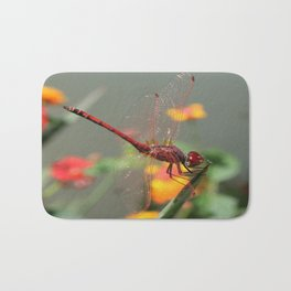 Red Skimmer or Firecracker Dragonfly With Lantana Background Bath Mat
