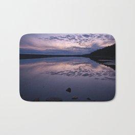 Sunset on a lake Bath Mat
