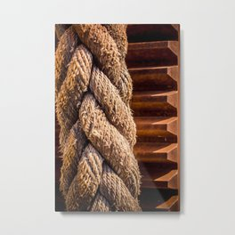 Thick braided rope from a boat, tied to a cogwheel Metal Print