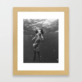 A Haunting Beauty Beneath the Surface  Framed Art Print