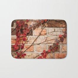 Red ivy leaves creeper on bricks wall Bath Mat