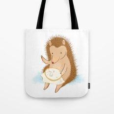 Hedgehog stitching a hedgehog Tote Bag