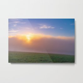 Sun shinning through the clouds onto grass field Metal Print