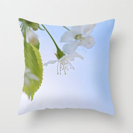 Macro shot of blooming apple tree over blue sky Throw Pillow