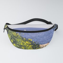Yellow flowers on the seacoast of Cap Martin in a sunny winter day Fanny Pack