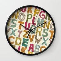alphabet Wall Clocks featuring ALPHABET by Matthew Taylor Wilson