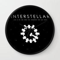 interstellar Wall Clocks featuring INTERSTELLAR by hkxdesign