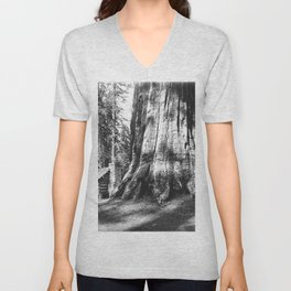 A log cabin dwarfed by a Big Tree in Mariposa Grove in Yosemite National Park, ca.1920 Unisex V-Neck
