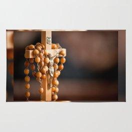 Jesus figurine and rosary Rug