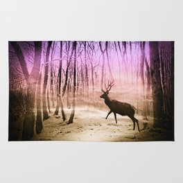 Deer in a foggy forest Rug