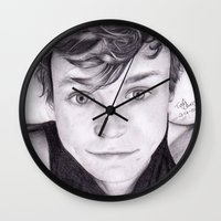 ashton irwin Wall Clocks featuring portrait of Ashton by teresartwork
