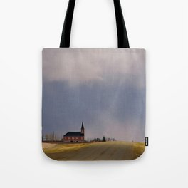 Distant Red Church on a Stormy Day Tote Bag