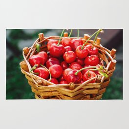 Wooden wicker basket with ripe red cherries Rug