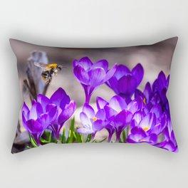 Flying bee over purple crocuses at flower bed in garden. Spring time. Rectangular Pillow