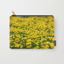 Small yellow wild flowers in the green field Carry-All Pouch