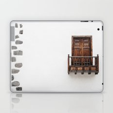 Wooden window door and balcony in a white wall. La Palma, Canary Island. Laptop & iPad Skin