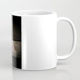 What wakes, when darkness falls? Coffee Mug
