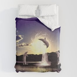 Dolphins play in the sunset Comforters