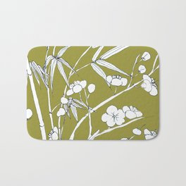 bamboo and plum flower in white on yellow Bath Mat
