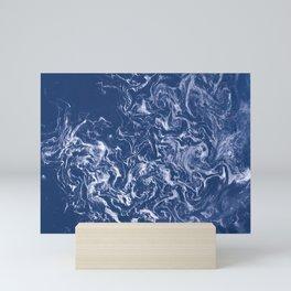 Sea ice floes swirl in Sea of Okhotsk Mini Art Print