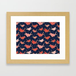 Red origami cranes on navy blue Framed Art Print