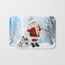 Santa Claus with funny penguin Bath Mat