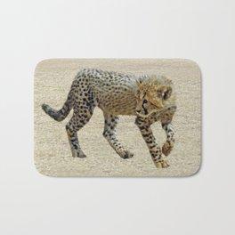Baby cheetah learning to stalk Bath Mat