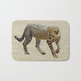 Baby cheetah learning to stalk Bath Mat