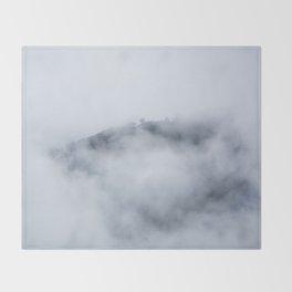 Trees through the foggy mountains Throw Blanket