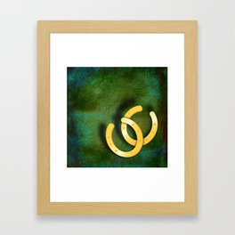 Lucky horseshoes on a textured green background Framed Art Print