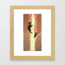 Black bears on tree Framed Art Print