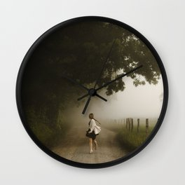 woman running down a lane in the country morning fog Wall Clock