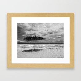 Lonely umbrella Framed Art Print