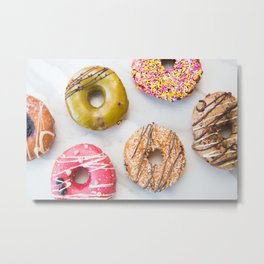 Colorful Donuts on Marble Metal Print
